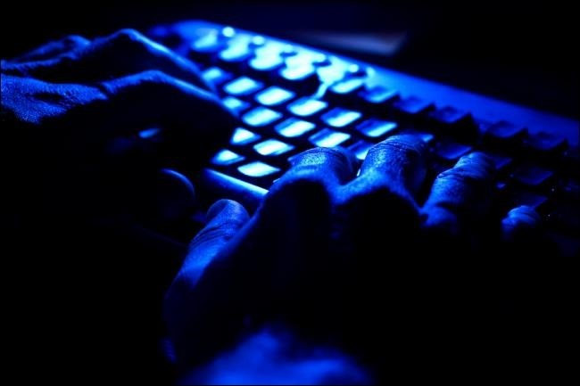 hands-on-keyboard-with-blue-light