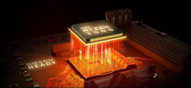 Процессор Ryzen 3000 с оранжевым светом проникает в гнездо материнской платы.